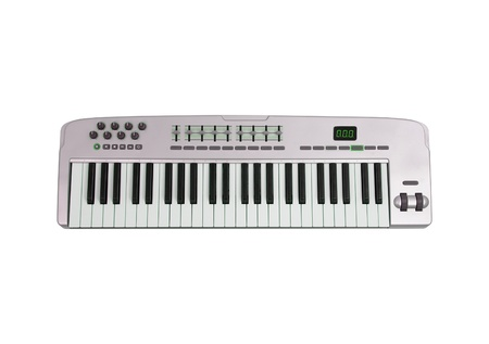 Teclado musical aislado en blanco photo
