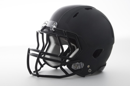 Casco de f�tbol americano negro sobre blanco photo
