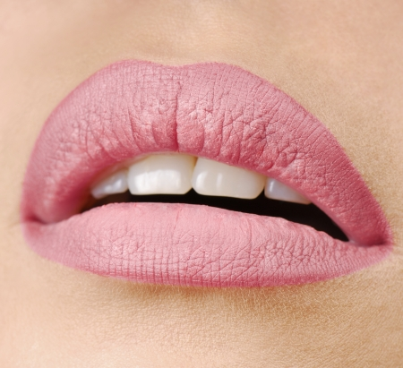 close-up portrait of young beautiful womans lips zone make up photo
