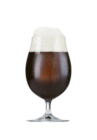 glass of brown beer on white background photo