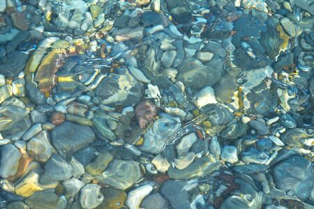 Rocks in a shallow pond photo