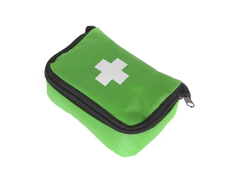First aid bag isolated on white photo