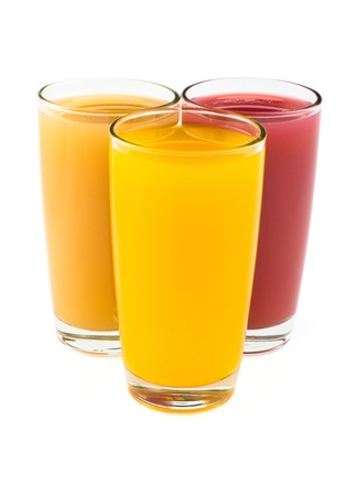 Tropical juices in glasses isolated on white Stock Photo - 15297899