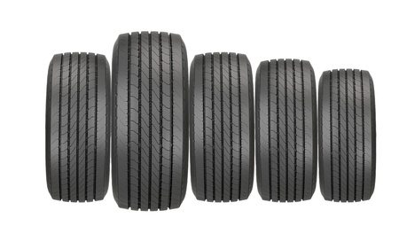 Column of tires isolated on the white background photo