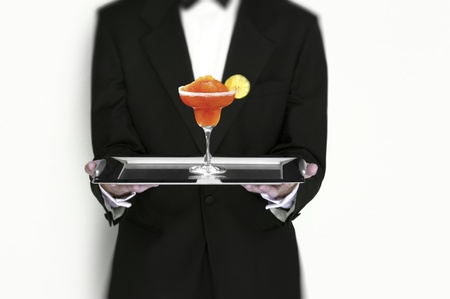 Manhattan Cocktail Being Served by Waiter on Silver Tray isolated Stock Photo - 15298455
