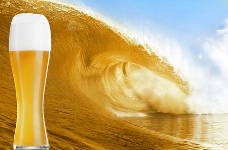 Gold beer glass over a big beer wave  photo
