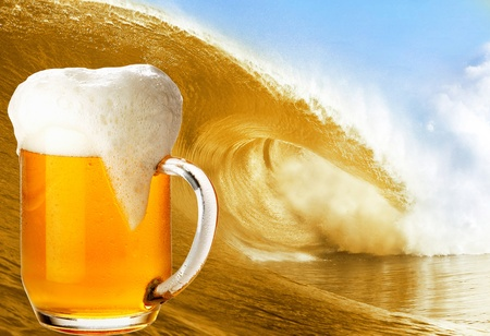 glass of gold beer over the big beer wave photo