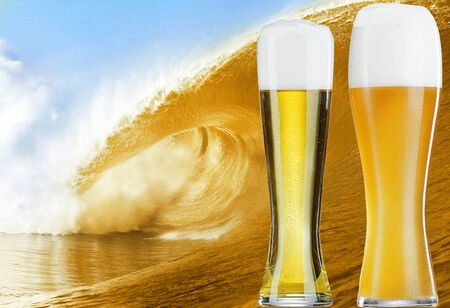 Two glasses of gold beer over the big beer wave photo