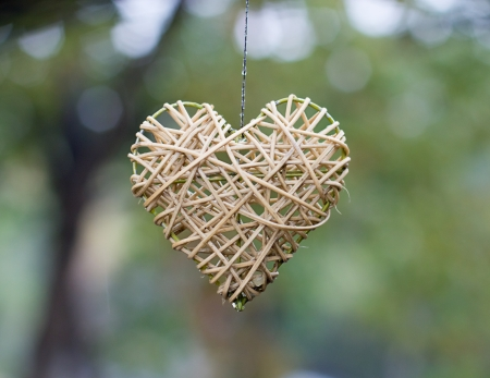 Wooden heart shaped figure photo
