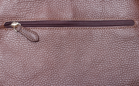 zipper on brown leather photo