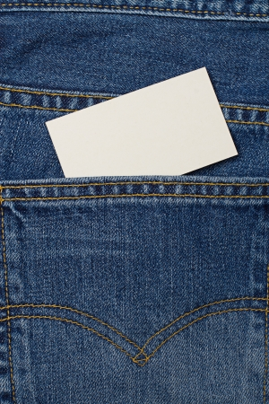 Blank card with copy space in a pocket of blue jeans photo