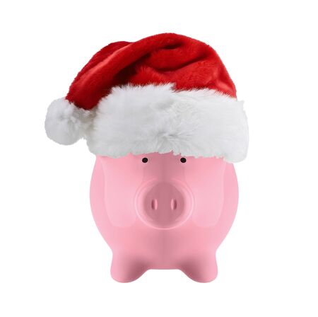 christmas debt: Piggy bank with christmas hat isolated on white