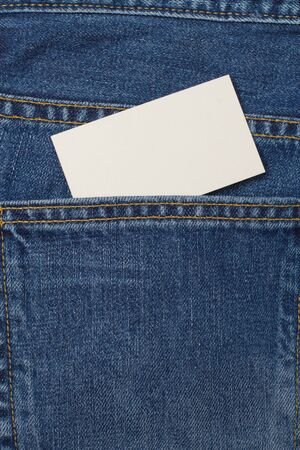 A denium blue jean pocket witn business card photo