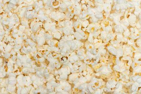 Salted popcorn grains on the white background Stock Photo - 16853253