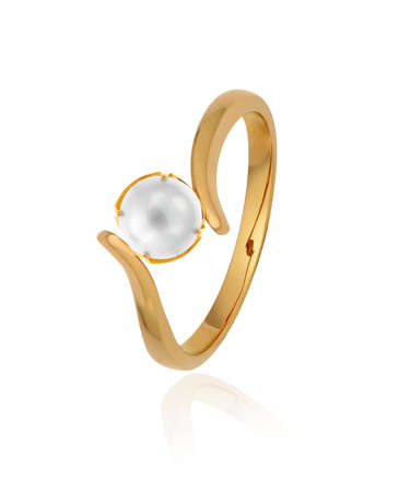 Gold ring with pearl on white photo