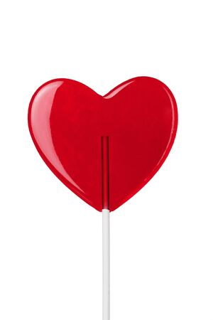 red heart-lollipop isolated on white photo