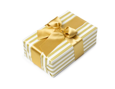 duo tone: Gift box in gold duo tone with golden satin ribbon and bow isolated over white background.