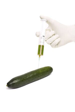 Bio genetics research of food , modified cucumber with syringe Stock Photo - 18921929