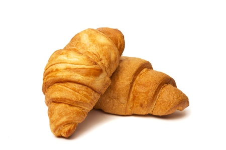 two croissants isolated on white background