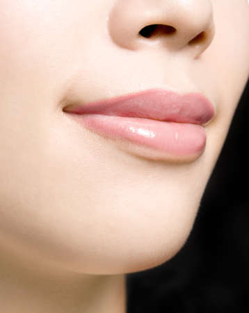 Young woman's glossy pink lips-copyspace Stock Photo - 21966453