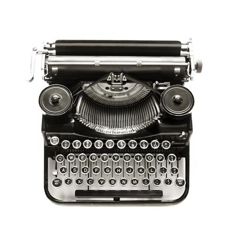 Antique typewriter against a crisp white backdrop. Standard-Bild