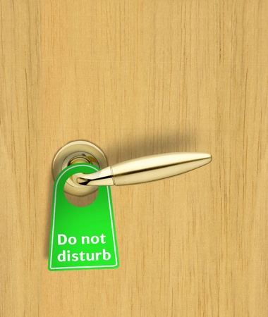 do not disturb: Hotel wood door with a Do not disturb sign