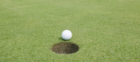 Close-up of a golf ball lying on the course photo