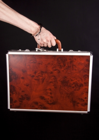 pawn adult: Hand man with a red briefcase