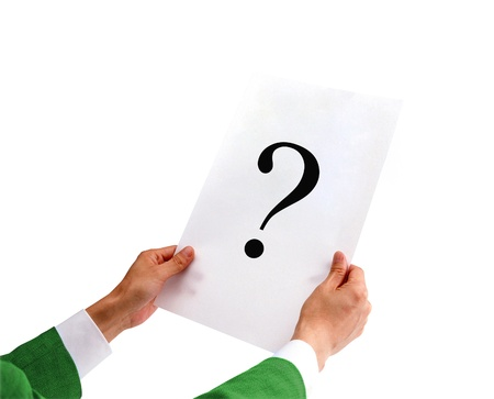 businessman holding a white paper with a question mark photo