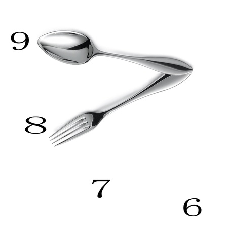 Clock made of spoon and fork isolated photo