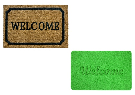 welcome mat: Welcome mats isolated over white Stock Photo