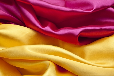 Silk background in pink and yellow colors Stock Photo - 21994191