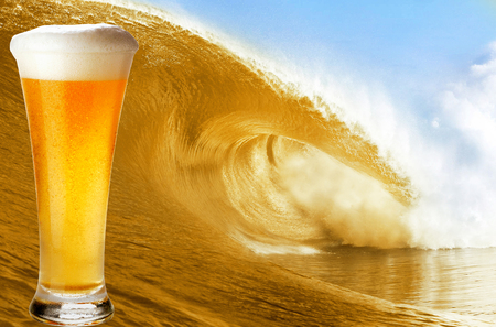 Gold beer glass over a big beer wave. photo