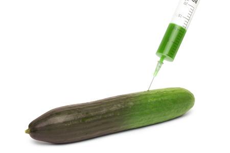 ehec: cucumber and syringe - concept Stock Photo