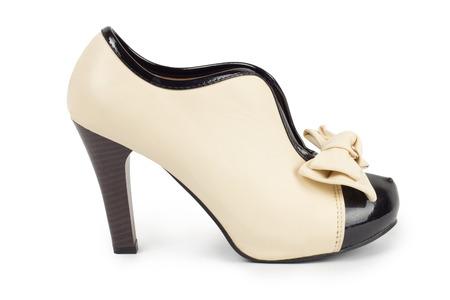 zapato de la mujer aislada sobre un fondo blanco photo