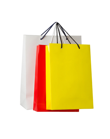 Assorted colored shopping bags on white background photo