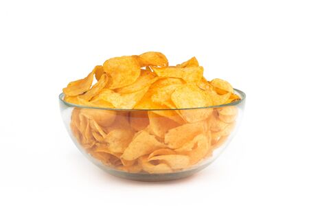 Bowl of potato chips isolated on white background photo
