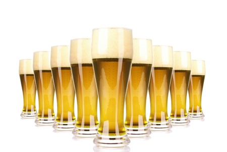 Frosty glass of beer with foam isolated on a white background photo