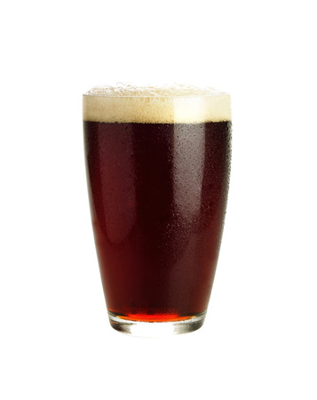 unstrained: Glass of dark beer isolated on white