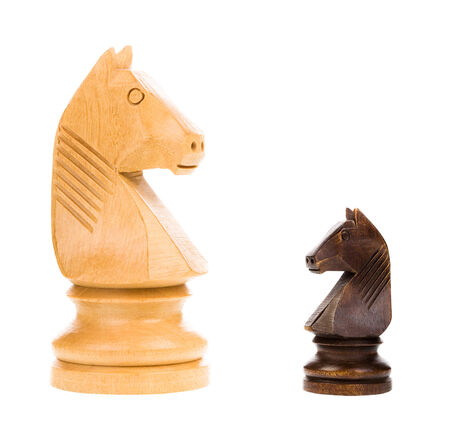two faced: Chess knights isolated on white background - concept Stock Photo