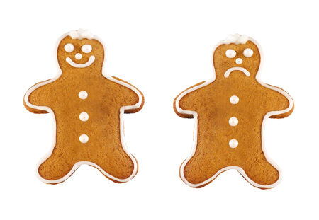 happy and sad gingerbread man isolated photo