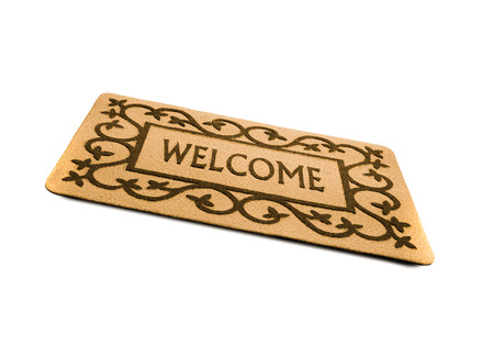 welcome door: Photo of a welcome door mat isolated on a white background.