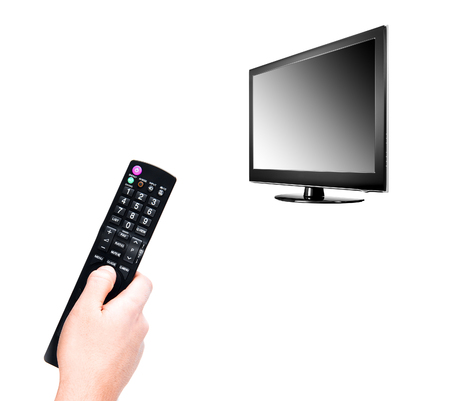 Hand with TV remote control isolated on white photo