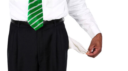pulling money: Man Pulling out Empty Pockets isolated Stock Photo