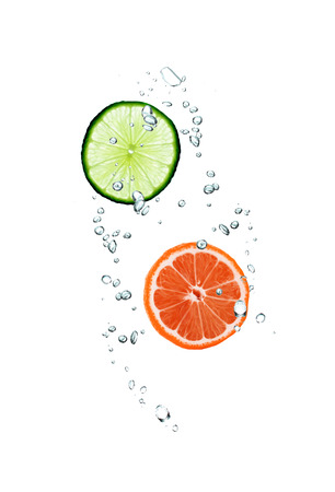 slice of grapefruit and lime in water photo