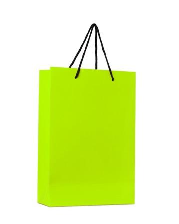 gift spending: green shopping bag isolated on white background