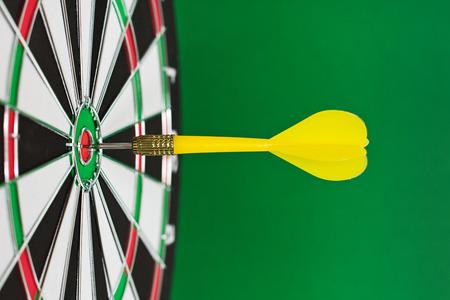 bullseye: Dart sticks to bullseye on a dart board
