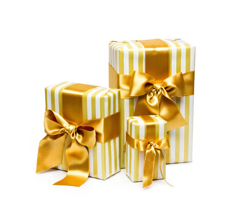 gold gift box: Gold gift boxes isolated on white background Stock Photo