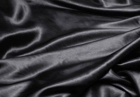 luxurious black satin background close up photo