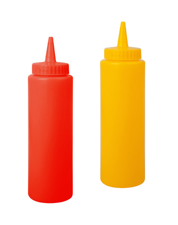 squirting ketchup: bottles of mustard and ketchup against white background Stock Photo